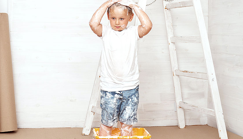 Boy getting messy with paint