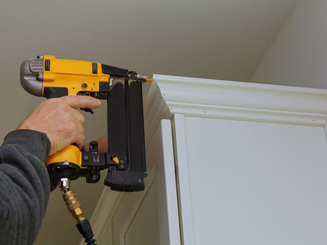 HBP Painting Contractors Installing Crown Molding on Cabinets