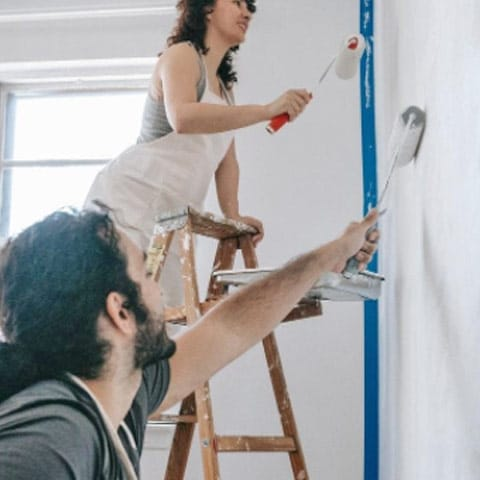 Couple painting the interior of their home