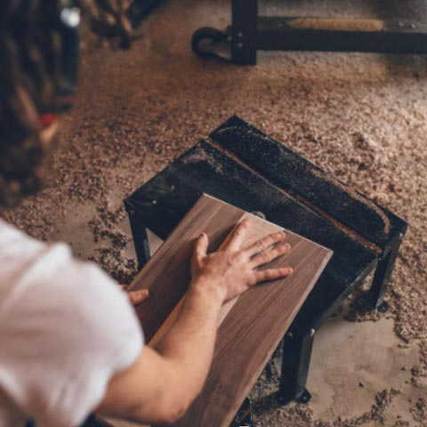 Woman sanding cabinets